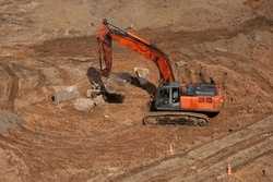 Big orange excavator, dozer shovel  on the construction site.