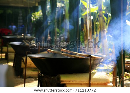 Big pans for cooking in the temple - Shutterstock ID 711210772