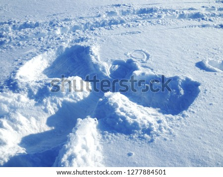 Big picture of the snow angel on clean snow
