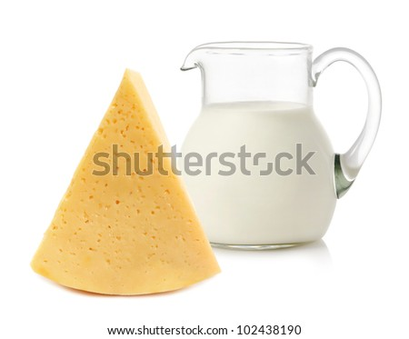 Big piece of cheese and glass jug with milk on white background