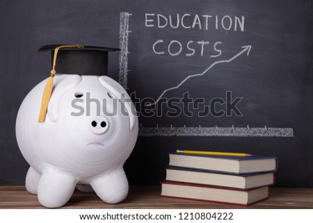 Big piggy bank with graduation cap is standing next to an education chart that is showing a rising trend in education costs