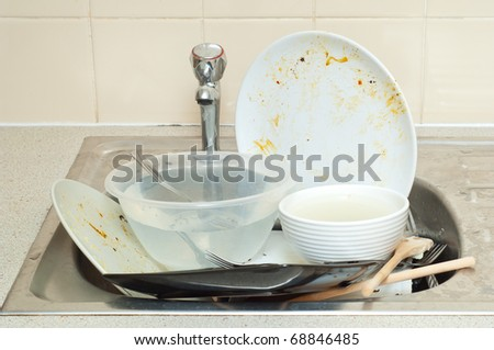 Big pile od dirty dishes