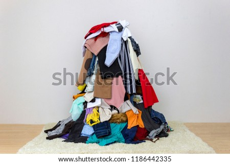 Big pile of clothes on the floor