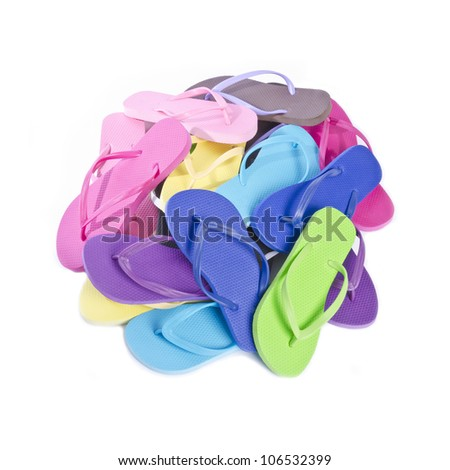 Big Pile of Colorful Flip Flops Isolated on White - stock photo