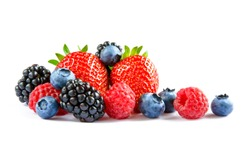 Big Pile of Fresh Berries on the White Background. Ripe Sweet Strawberry, Raspberry, Blueberry, Blackberry