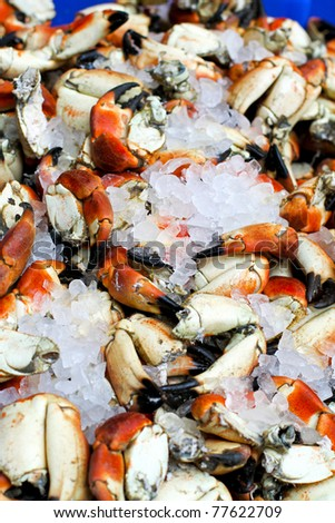 Big pile of fresh crabs sitting on ice