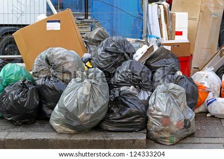 Big pile of garbage and waiste in black bags