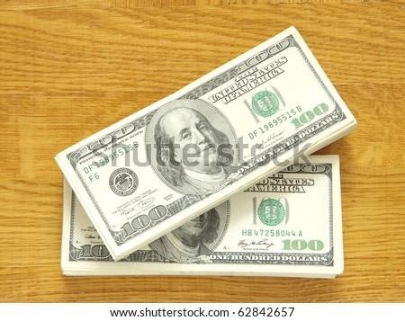 big pile of money over wood background