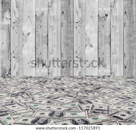 big pile of money. stack of american dollars on the wood backgrounds