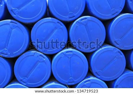 big pile of stacked blue barrels