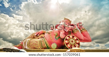 Big pink Ganesha statue in relaxing action Thailand