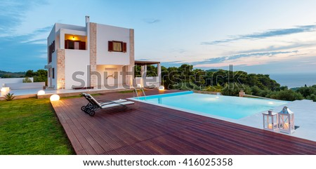 big  pool and luxury villa in the afternoon
