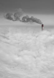 Big power station chimney with smoke above the city smog