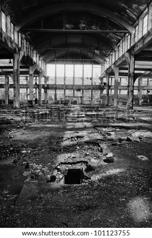 big production hall in the abandoned factory, black and white