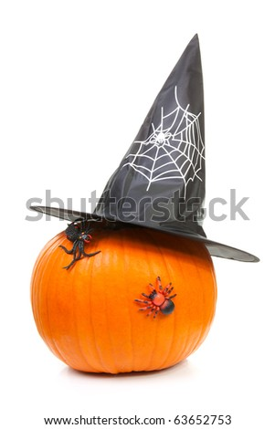 big pumpkin with black witch hat and spiders for halloween isolated on white background