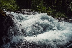 Big rapids of powerful mountain river. Beautiful background with azure water in fast river. Frozen motion of tall mountain river rapids. Power majestic nature of highlands. Backdrop of aqua turbulence