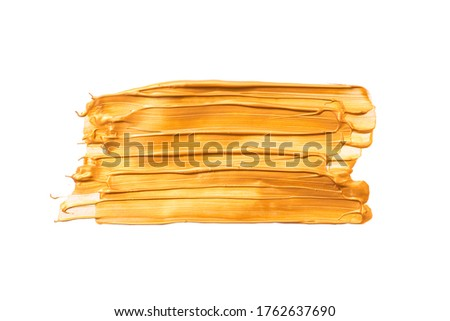 Big Rectangular gold brush strokes or smears isolated on white background. Top view. Mock up with copy space. Golden metallic make-up smear swatch sample Сток-фото ©