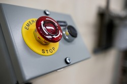 Big Red emergency button or stop button for manual pressing. STOP button for industrial equipment, emergency stop. Red light. At the factory and industrial facility
