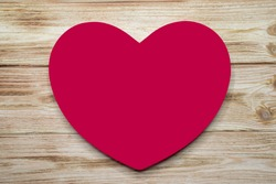Big red heart on old rustic wooden background. Mock up, template for Valentine`s Day advertising, romantic greeting card.