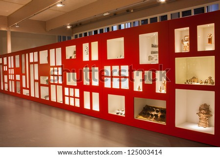 Big red museum display with relics