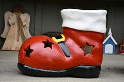 Big red Santa Claus boot on a porch