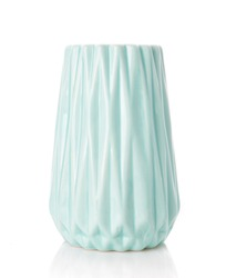 Big ribbed vase of turquoise color on a white background. Vase for flowers. Home decor.