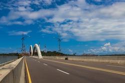big road over the pedestrian bridge to Dompak Island