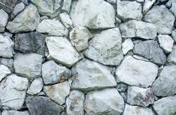 Big rock several cubes. Build a wall.