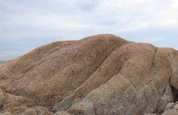 Big rocks block the sea and sky.