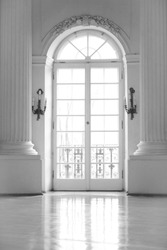 Big room with old big window and misty light in black white style