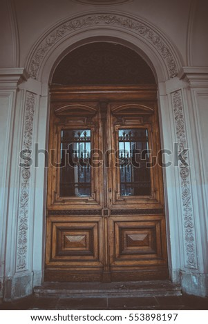 Big Round Old Wooden Outside Door With Glass