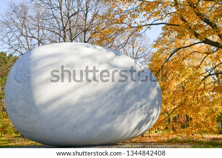Big round zen rock landmark in garden with autumn leaves background, Concept image for peace and serene moments. #1344842408