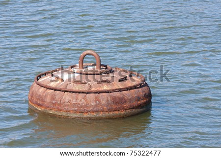 Big rusty buoy for the mooring of ships