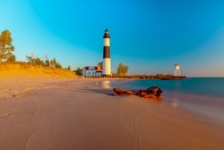 Big Sable Lighthouse in Ludington, Michigan  basks in the sun during golden hour.