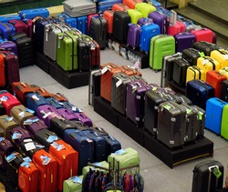 Big sale in store. Travel suitcases of different sizes and colors and goods .