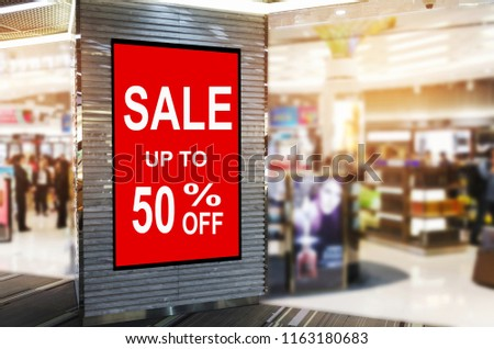 big sale 50% mock up advertise billboard or advertising light box in department store shopping mall or airport, special offer, commercial, marketing and advertisement concept