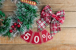 Big sales 50%, fifty percents with Christmas wreath on a old barn plank background, top view, copy space. Christmas big sale.