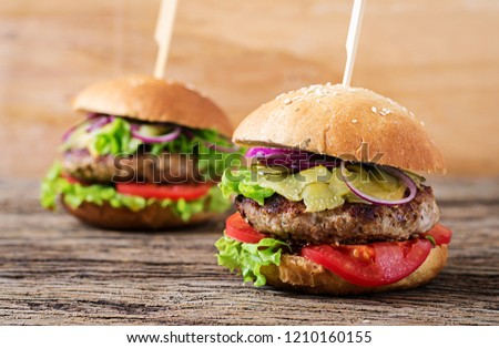 Big sandwich - hamburger burger with beef,  tomato, cheese and pickled cucumber.  Street food.