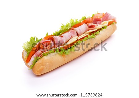 Big Sandwich on Long Baguette with Lettuce, Tomatoes, Cheese and Ham isolated on white background