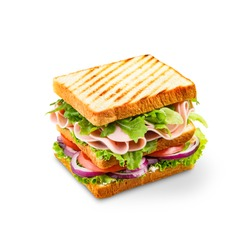 Big sandwich with ham, salad, and tomatoes