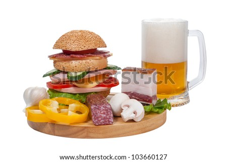 Big sandwich with sausage and vegetables, bacon and vegetables on cutting board, mug beer isolated on white background - stock photo