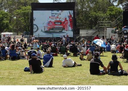 Big screen at a motor race...