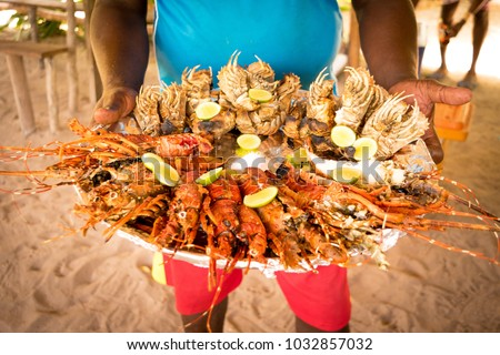 Big seafood plate served during a Blue Safari, Fumba area, Zanzibar, Tanzania.