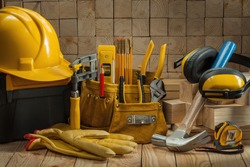 big set of construction carpentry tools on wooden background