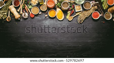 Big set of Indian spices and herbs . On the black chalkboard.