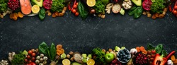 Big set of vegetables, fruits, berries and food on a black stone background. Free space for text. Top view.