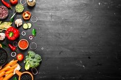 Big set organic food. Fresh raw vegetables. On a black chalkboard.