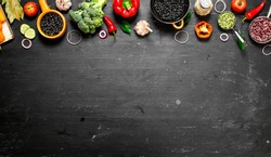 Big set organic food. Fresh raw vegetables. On a black chalkboard.