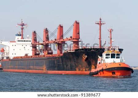 Big ship and tugboat. Gdansk, Poland.