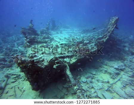 Big ship wreck boat underwater view. Diving picture with deep mood atmosphere. Beauty of sea oceans dark waters with wildlife fishes, corals and shells. Abstract landscape scenery, dive site objects